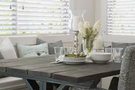 gray dining room table with plates and cups