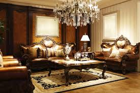 elegant formal living room with leather furniture and chandelier