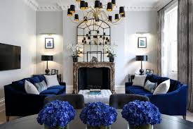 grey and blue living room with velvet navy sofa n99
