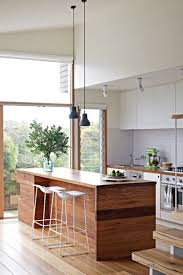 pendant lighting over kitchen island. twp simple pendant lights hung at different heights play with the open space created by lighting over kitchen island h