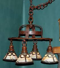 arts and crafts hammered copper handel chandelier with slag glass tulip design shades
