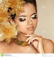 eye makeup beautiful with golden flowers beauty model woman face perfect skin