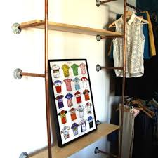 industrial copper pipe and reclaimed wood shelving unit storage