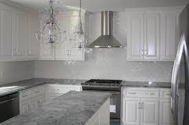 nice chandelier over kitchen island feat gray quartz countertop and herringbone backsplash tile elegant grey