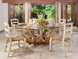 driftwood plus round glass top for dining table on white stone flooring with sisal chairs arrangement