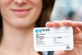 hand holding blue cross id card