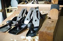 woodworking planes. stanley planes sitting on a woodworking workbench next to wood plane n