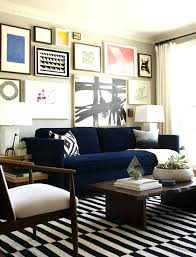 blue couch in living room sofa blue stripes rug white curtains navy blue living room furniture
