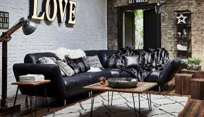 a rustic theme full of texture and warmth using reclaimed wood aged leather and well worn metal fill this trend create a drama filled home