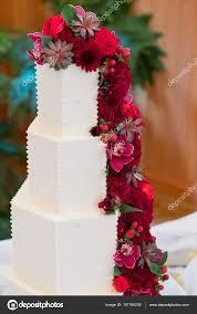 Tower Wedding Cake With Red Flowers Stock Photo Joshuarainey