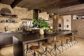 Rustic kitchens designs Elegant Stone Wall Ceiling Beams And Barnlike Door Add Rustic Touches To The Otherwise Contemporary Kitchen Of Malibu Beach House Designed By Michael Lee Architectural Digest 29 Rustic Kitchen Ideas Youll Want To Copy Architectural Digest