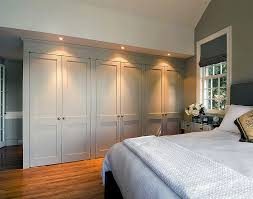 wardrobe lighting ideas. built in wardrobe wall with lights above would like tall mirrors doors though to reflect more light lighting ideas