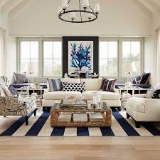 living rooms modern coastal living room with white sofa and wicker coffee table and striped