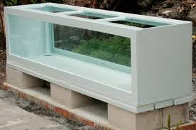 the completed aquarium on its stand a sheet of 1 styrofoam material has been placed between the wood supports and the aquarium s bottom for cushioning