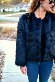 ashley from lsr in a navy faux fur coat