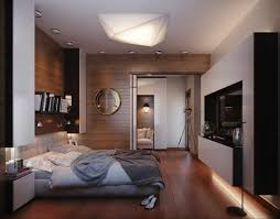 bedroom: Classy Double Bed On Wooden Floor Under Interesting Lighting Near  TV Cabinet Plus Unique