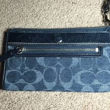 HP Coach Denim Signature Zippy Wallet (F50871) NWOT   . Large Coach  wristlet wallet. Dark denim with light blue large C s. Front has round  enamel Coach logo ...