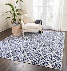 bolivia white blue area rug features a time honored damask pattern in navy