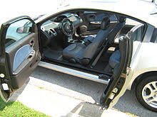 saturn ion quad coupe with its half rear doors open