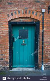 turquoise painted front door with black frame of cottage at tenbury wells worcestershire england uk