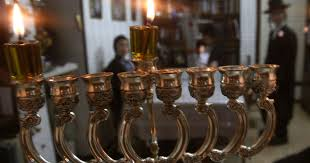 why do jews light hanukkah candles anyway