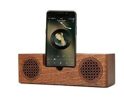 china mini wooden bluetooth speaker 1200mah battery phone charger holder supplier