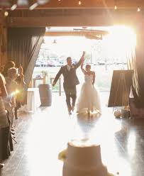 100 wedding entrance songs Wedding Entourage Reception Entrance Songs bride and groom entrance at barn wedding reception Entrance to Reception Wedding Party
