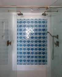 blue fan pattern shower tiles