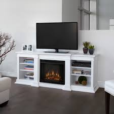 modern electric fireplace insert with black frame and books case and wooden floor plus television for