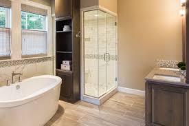 bathroom in luxury home bathtub and shower