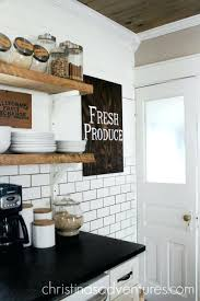 leathered granite countertops farmhouse kitchen with open shelving wood ceiling and black pros cons