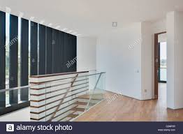 Modern White Landing At Top Of Stairs With Timber Floor And Open Door Landing Stairs