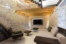 stone house furniture. entertainment room with stone walls and wood beams house furniture p