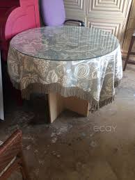 round table glass top with table cloth