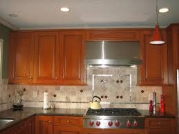 gas stove top cabinet. Spellbinding Kitchen Backsplash Glass Tile Design Ideas Alongside Stainless Steel Range Hood Under Cabinet Over Wolf Gas Stove Top K