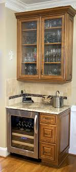 these clients included a beautiful beverage center featuring kraftmaid cabinets backed with sage green bead board and seeded glass cabinet doors