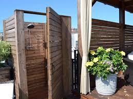 contemporary outdoor shower decoration ideas with white potted plants and wooden shower enclosure also white fabric shower curtain complete with round head