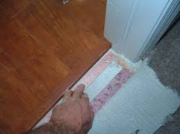 here we will nail the tack strip in front of the laminate transition so we can