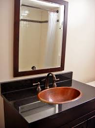 bathroom sink decor. Bathroom Vanity With 17-inch Oval Copper Sink And Black Counter Decor
