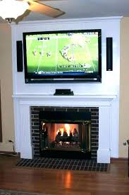tv above fireplace hide wires behind how to for wall mounted over info where put