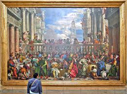 the wedding feast at cana louvre with this person in the picture it gives you an idea of how large this painting is