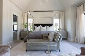 chrome canopy bed with black headboard