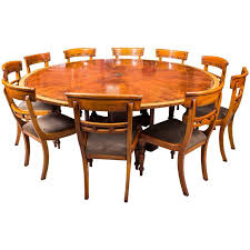 theodore alexander 7ft diameter flame mahogany jupe dining table 10 chairs ref no 08166a