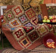 Amazon.com: Simple Comforts: 12 Cozy Lap Quilts (9781564778482 ... & One of my favorite quilt patterns! Churn Dash pattern with a NinePatch in  the middle- love those fall colors! Adamdwight.com