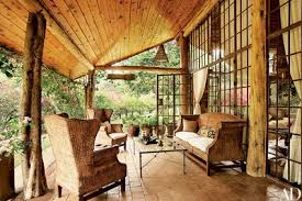 Log cabin interiors designs Rustic Log Chairs And Sofa Made Of Woven Water Hyacinth Decorate The Terrace Of This Paul Verleysendesigned Log House In Kenya Tribal Cloth From Congo Covers How To Elegantly Style Log Home Architectural Digest