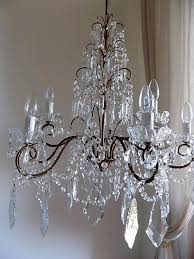 italian vintage 9 arms solid brass chandelier with rare shaped crystals