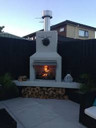 an outdoor fireplace from aztec fires is just what you need to transform your outside living area cosy and warm fun and entertaining friends and family