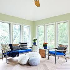 mid sized trendy light wood floor and beige floor sunroom photo in dc metro with