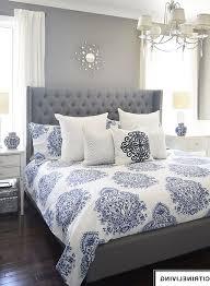 bedroom blue grey and white bedroom dark pink cozy blanket beige furry rug polished brown