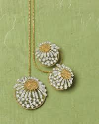 tanishq zyra collection white and yellow gold sunflower earrings and necklace studded with white diamonds